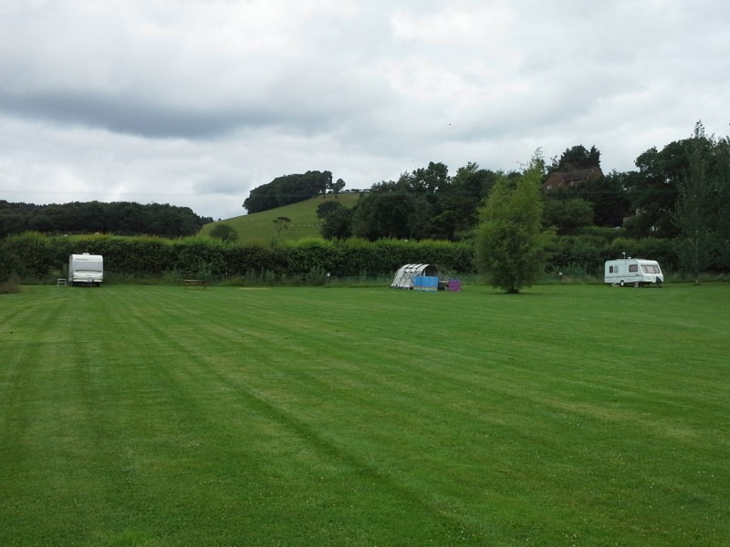 caravan-tent-sheep-hill-view